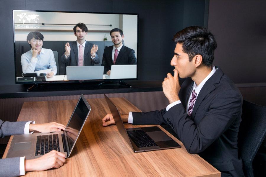 Videoconferencing in meeting room.