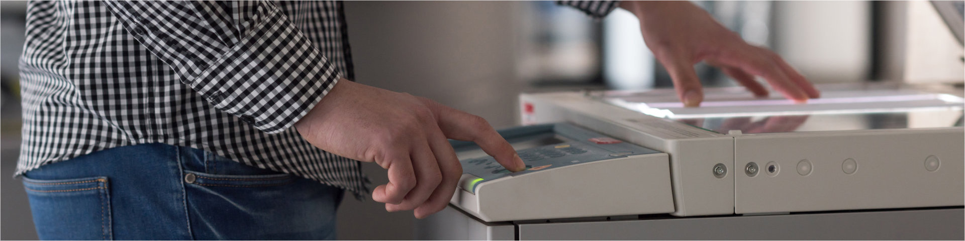 a man pushing a button in a photocopier machine